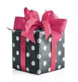 Polka dot Gift box with pink ribbon. Polka dot Gift box with  pink  ribbon isolated on white background with clipping path Royalty Free Stock Images
