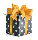 Polka dot Gift box with yellow ribbon. Isolated on white background with clipping path Royalty Free Stock Photography