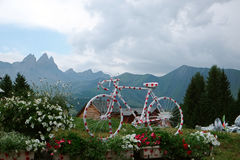 Polka dot painted road bike. A polka dot painted racing bike put up in the french alps, as an eye catcher for the tour de france Stock Photo