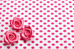 Polka dot paper and pink roses Stock Photos