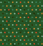 Polka dot pattern on green background Stock Image