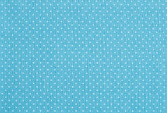 Polka dot pattern. Pale blue fabric with white polka dot pattern Royalty Free Stock Photography