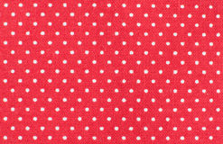 Polka dot pattern. Red fabric with white polka dot pattern, micro shot Royalty Free Stock Image