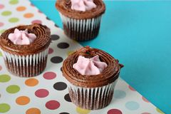 Polka dot raspberry filled cupcakes Stock Photo