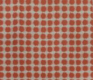 Polka dot red brown and white fabric pattern surface texture. Close-up of interior material for design decoration background royalty free stock photo