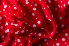 Polka dot on red canvas cotton texture, fabric background royalty free stock image