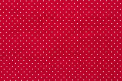 Polka dot on red canvas cotton texture, fabric background. Hi res stock photo