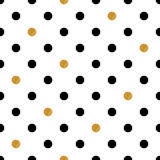 Polka dot seamless background in gold and black colors. Royalty Free Stock Image