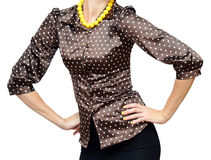 Polka-dot shirt. Woman with hands on each side in polka-dot shirt and yellow beads Royalty Free Stock Photography