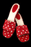 Polka-dot Shoes 1. Red and white polka-dot shoes isolated on a black background.  With clipping path Royalty Free Stock Image