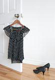 Polka Dot Shoes And Blouse On A Hanger Stock Images