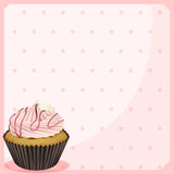 A polka dot stationery with a cupcake Stock Image