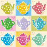 Polka-dot teapots Stock Images