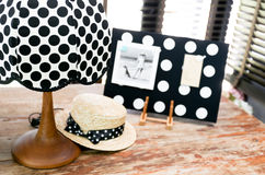 Polka dot vintage lamp on a wooden table Stock Photos