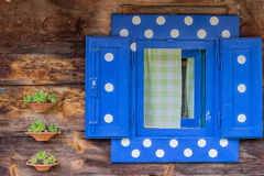 Polka dot window of a wooden house wall 2 Stock Images