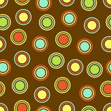 Polka Dots Background. Polka Dots pattern in bright colors on brown background Stock Photo