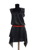 Polka dots dress with red belt on mannequin. Stock Image