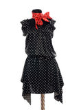 Polka dots dress with red scarf on mannequin. Royalty Free Stock Photos