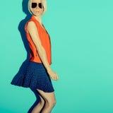 Polka dots fashion style. Glamorous lady party on blue backgroun Royalty Free Stock Photo