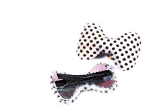 Polka dots hair clips. Beautiful shot of polka dots hair clips on white background stock photography
