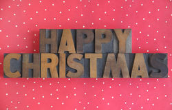 Polka dots Happy Christmas. The words 'happy Christmas' in old wood type on a polka dot background Stock Photo