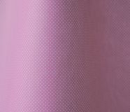Polka dots on pale pink. White polka dots on a curved pink background stock images