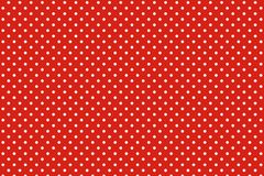 Polka dots. Pattern on red background stock image