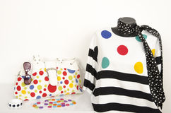 Polka dots and stripes blouse on mannequin with matching accessories. Stock Photos