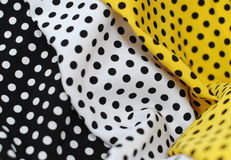Polka dots textile. Yellow, white and black textile with dots Stock Images