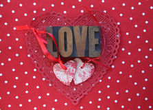 Polka dots and Valentine hearts Stock Images