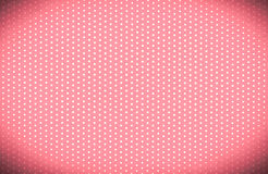 Polka dots. White dots on red paper,dark vignette royalty free stock images
