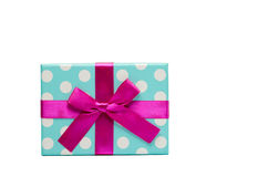 Polka dotted gift box with pink ribbon bow isolated on white background, just add your own text. Use for Christmas. Polka dotted gift box with pink ribbon bow Stock Photography