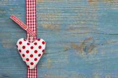 Polka dotted heart on blue wooden surface in country style for g Royalty Free Stock Photos