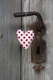 Polka dotted heart shape hanging on door handle - handmade - woo royalty free stock photography