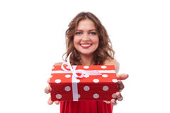 Polka dotted present box holding by pretty woman royalty free stock images