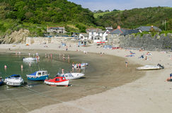Polkerris,Cornwall,UK - August 1st 2010: Tourists and boats on t. He andy beach of Polkerris a famous holiday destination in the west country Royalty Free Stock Image