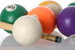 Pool Balls and Cue. Pool balls and end of cue with reflection Royalty Free Stock Photo
