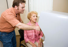 Poll Worker Assists Sr. Voter Royalty Free Stock Photo