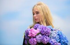 Pollen allergy. Gentle flower for delicate woman. Girl tender blonde hold hydrangea flowers bouquet. Allergy free life. Stop allergy blooming season. Enjoy stock photo