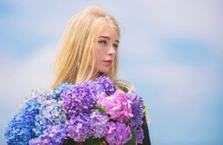 Pollen allergy. Gentle flower for delicate woman. Girl tender blonde hold hydrangea flowers bouquet. Allergy free life. Stop allergy blooming season. Enjoy royalty free stock photography