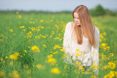 Pollen allergy, girl sneezing in a field of flowers. Pollen allergy, girl sneezing in a field of flowers Royalty Free Stock Photo