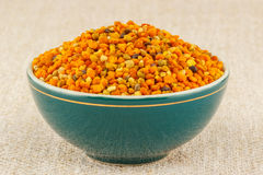 Pollen granules in bowl. Pollen granules in green porcelain bowl on rustic table cloth stock photo