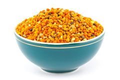 Pollen granules in bowl. Pollen granules in green porcelain bowl on white isolated background royalty free stock photos