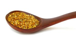 Pollen granules in wooden spoon Royalty Free Stock Photo