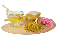 Pollen, honey and honeycomb on pallet Royalty Free Stock Images