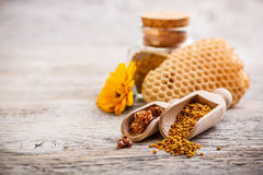 Pollen and propolis. Bee pollen granules and propolis in wooden scoop Stock Images