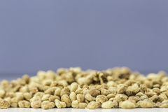 Pollen. Yellow bee pollen with a blue background Stock Photography