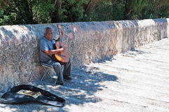 Pollenca, Pollensa, Mallorca, Majorca, Balearic Islands, Spain. A guitar player seated on the Calvary steps in Pollenca on June 6, 2012. There are a lot of Royalty Free Stock Photos