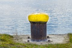 Poller bollard capstan on the river danube at the shore stock images