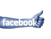 Pollice blu del facebook in su Fotografia Stock